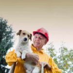 Man rescues small dog. Before disaster strikes, be sure you have a pet emergency plan.