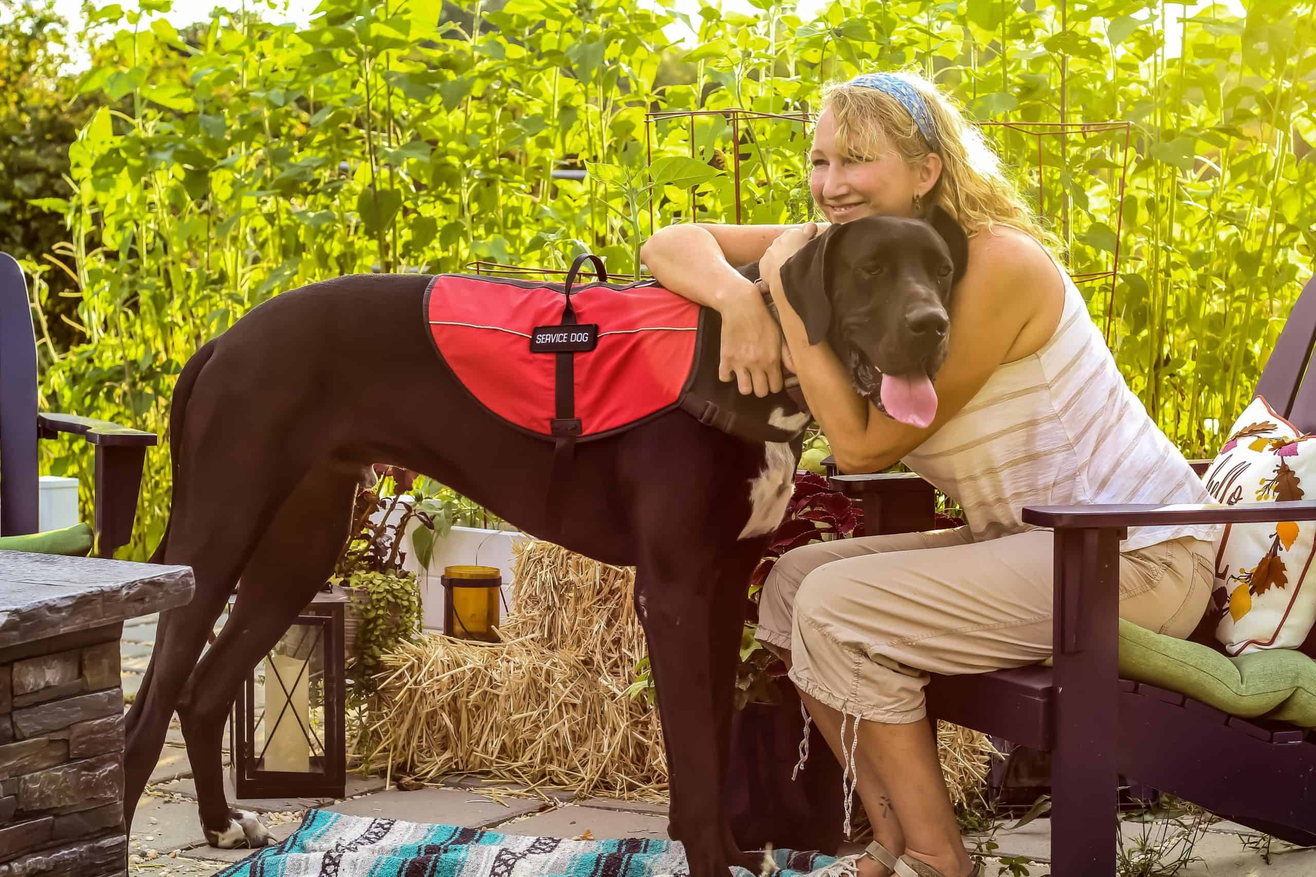 Woman hugs her service dog. You have options, whether you need a pet with you at college because you have a medical condition or feel emotionally dependent on an animal that gives you the support and comfort you need to leverage success.