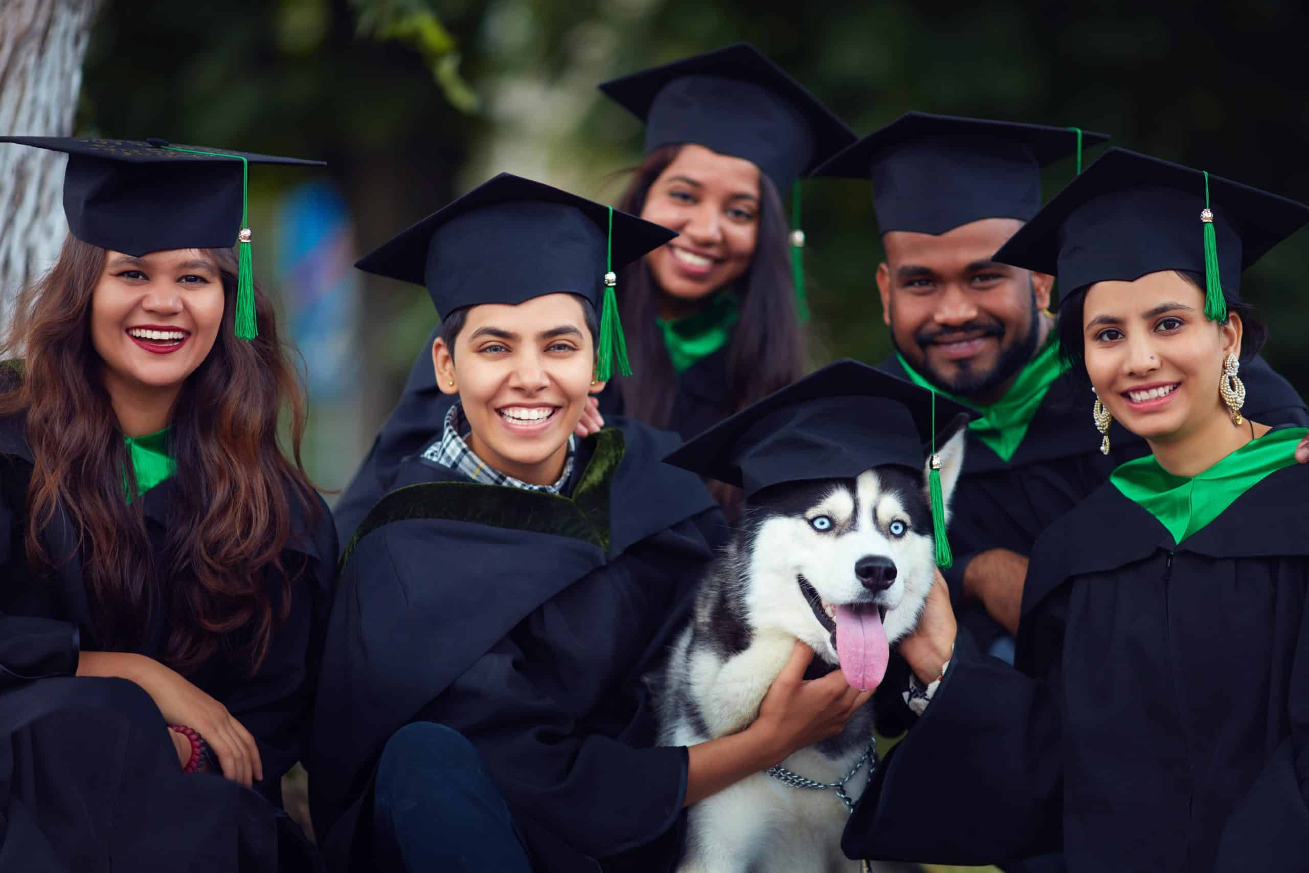 Graduates celebrate with Husky dog wearing a graduation cap. When you train your pet for college, scope out your living situation to make sure it's suitable for the animal's size and nature.