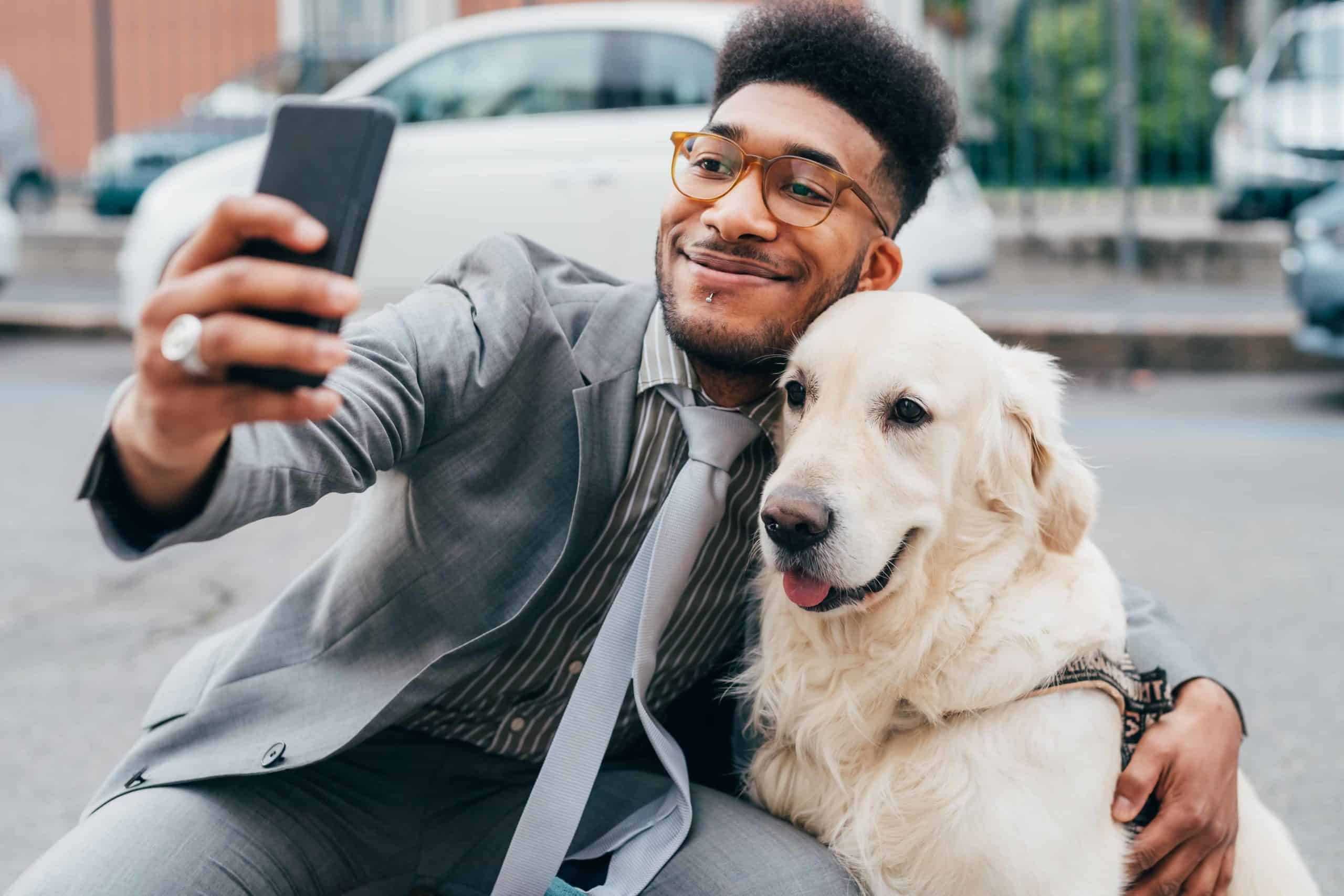 Man poses for selfie with his golden retriever. Adding dog pictures to a dating profile on Bumble provided 22% more matches and 30% more total interactions for women, while men with their dogs received 45% matches and 39% more total interactions.