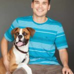Kyle Goguen, founder of Pawstruck.com, and Tyson, the company's chief canine officer.